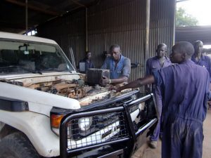 An automobile repair shop in Juba, which JVC assisted before the independence of South Sudan. It is now operated by South Sudanese mechanics and staff.